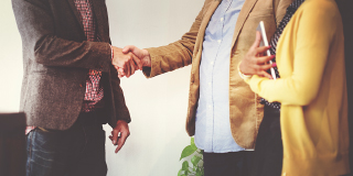 Business people doing a handshake